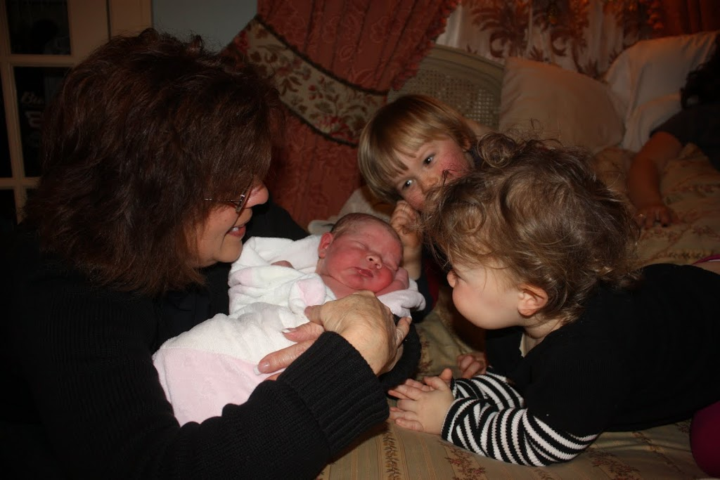 baby Juliette Élisabeth surrounded by siblings and grandmother
