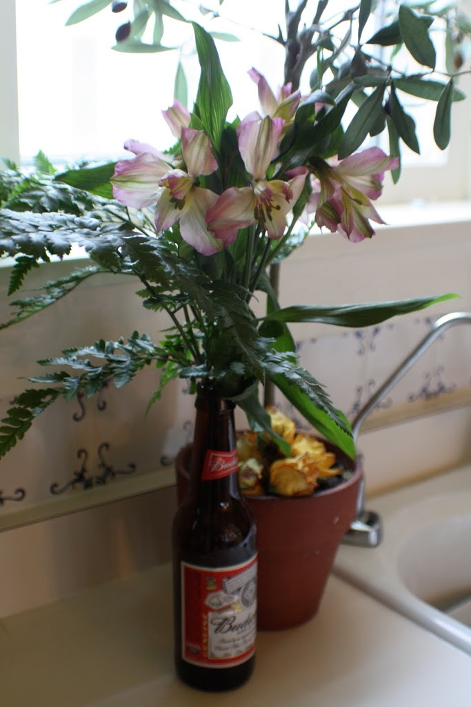 flowers in a beer bottle vase