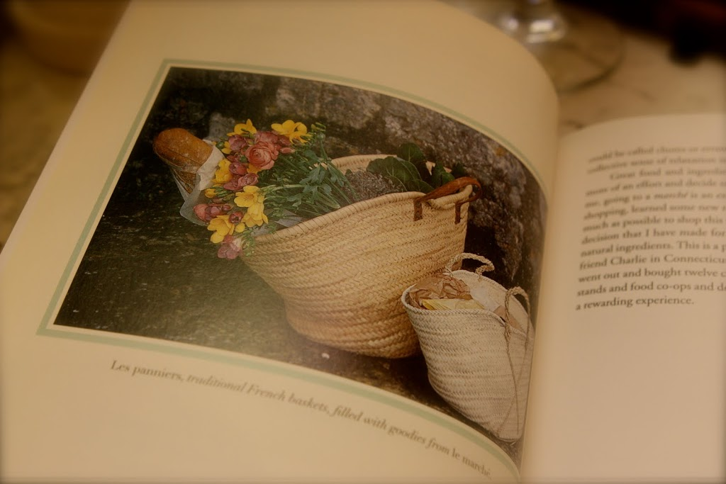 book showing a basket of flowers and bread