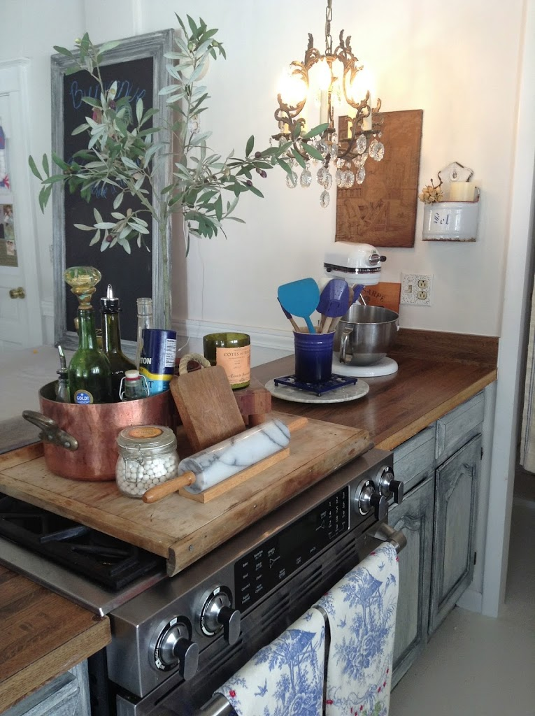 kitchen islands with small trees and cooking gear