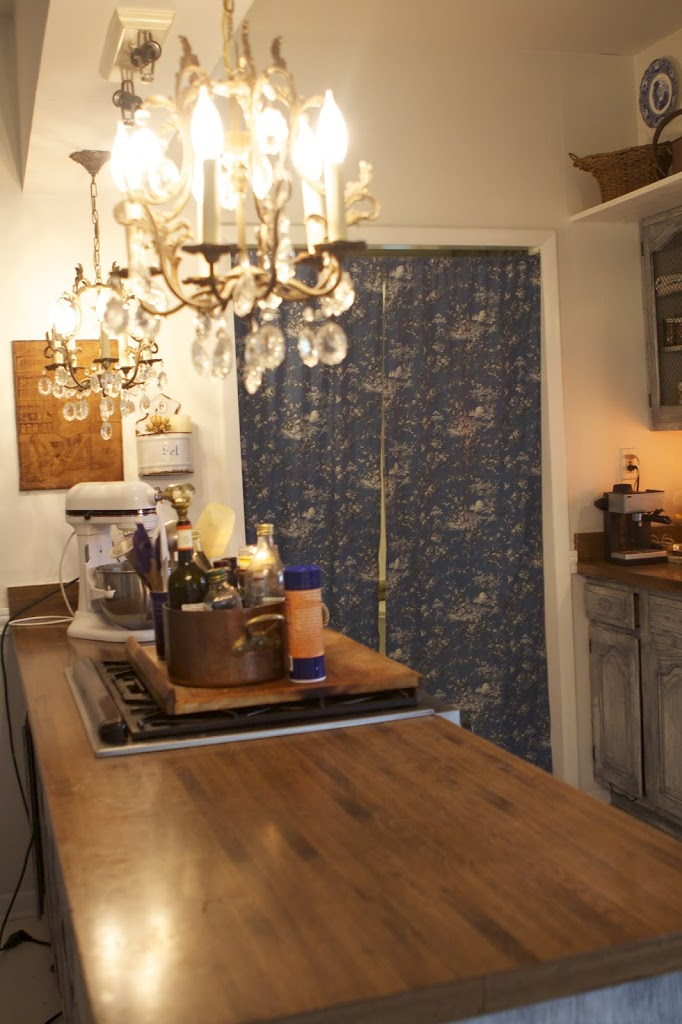 view of long kitchen counter with cloth door