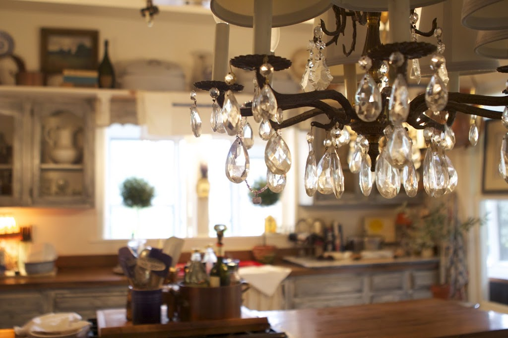 view from a chandelier into kitchen