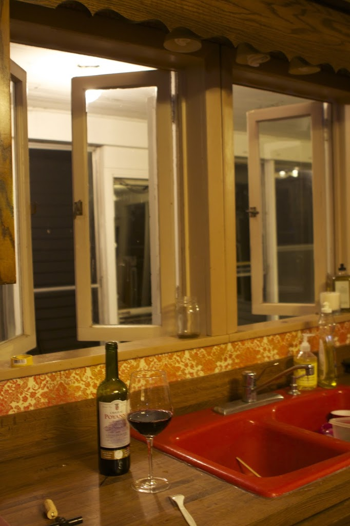kitchen sink with wine and open windows