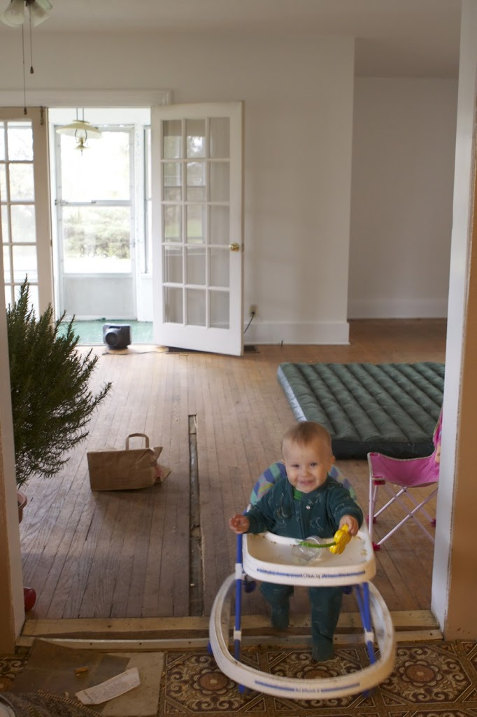 vacant kitchen with baby scooting around