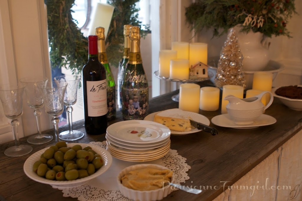 table display of wine and snacks and Christmas decorations