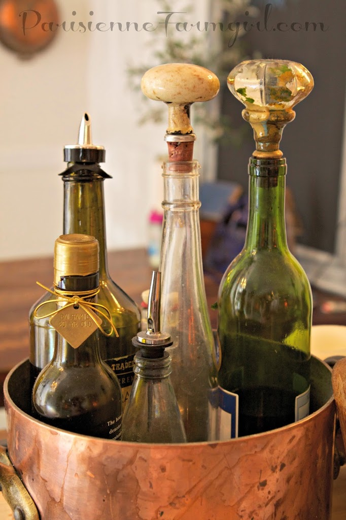 copper wine bottle holder with oil and vinegar bottles